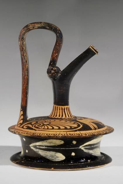 Apulian Red-Figure Epichysis with an Eros, 4th Century BC, South Italian, Terracotta, e~Tiquities auction house.