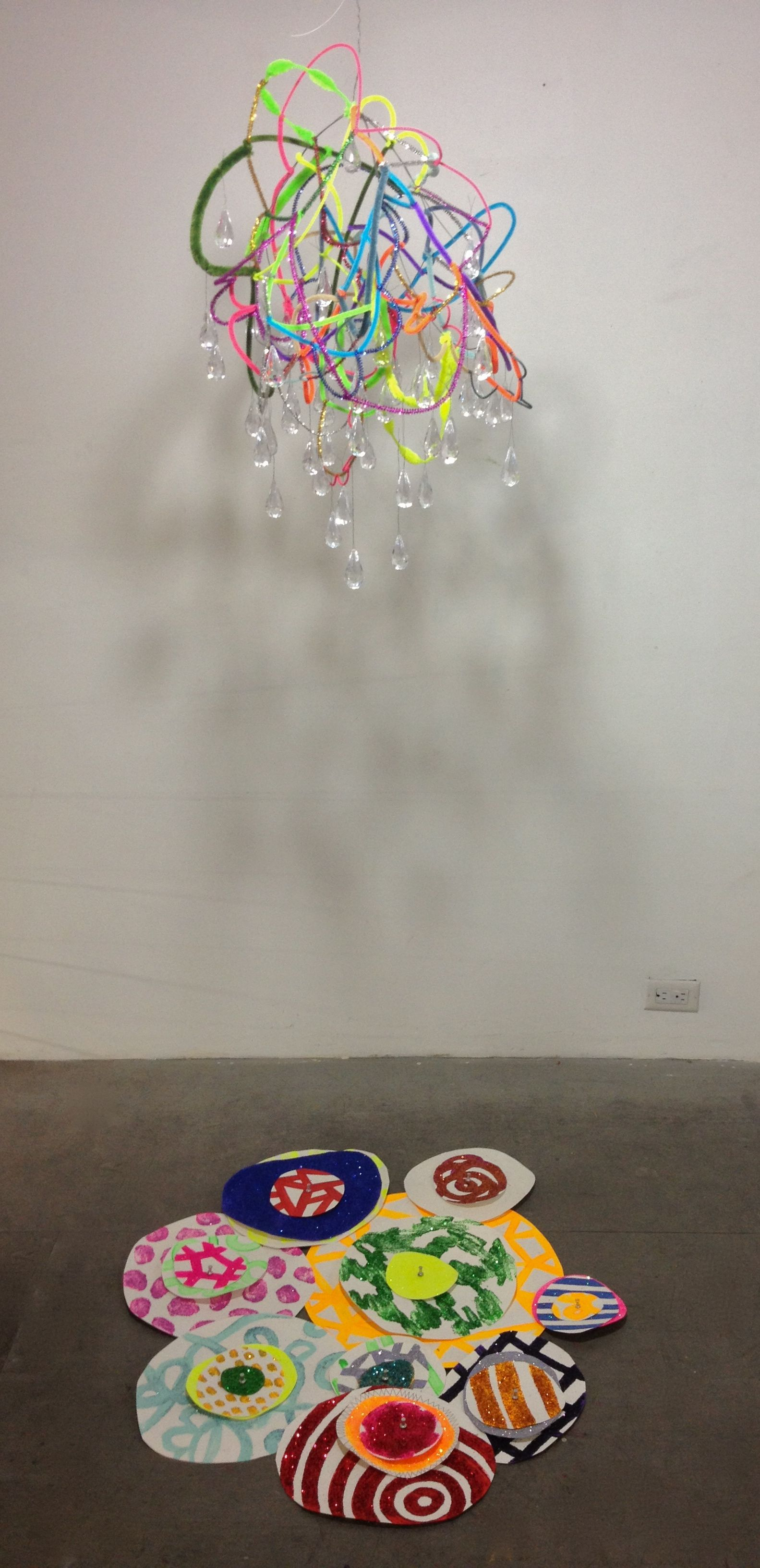 colorful installation mobile cloud over glittery floor drips