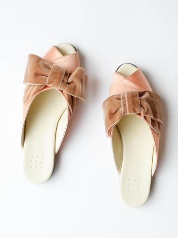 12700c0dd77a43 Satin criss cross pajama slide with tonal velvet bow. Kid leather sole.  Made in Italy