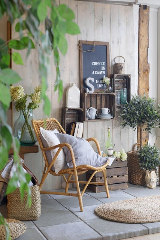 Recycled crates and  wicker chair give this patio french country look diy garden ideas outdoor apartment balconies also cozy to design your balcony make public view private rh pinterest