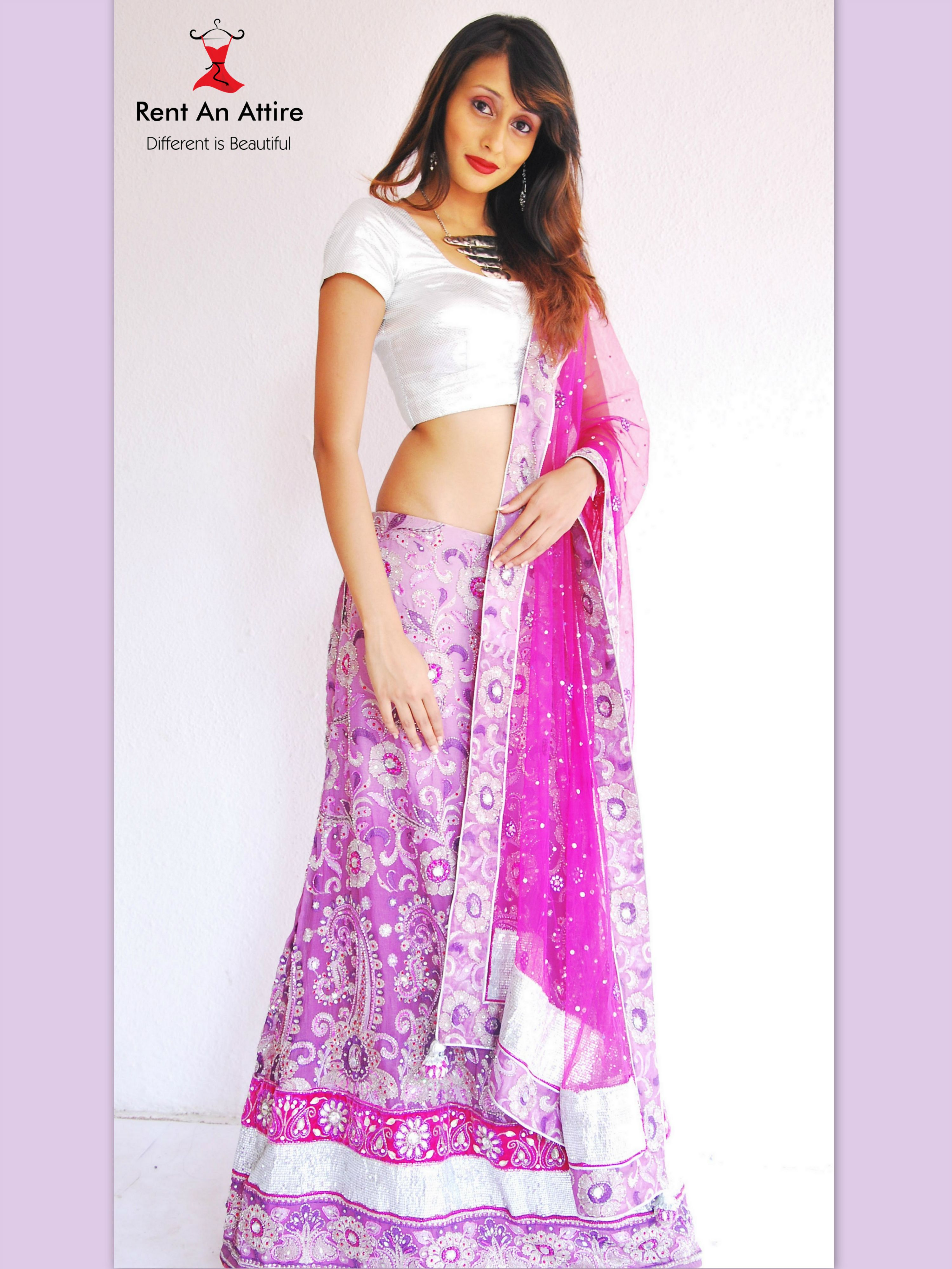 Vivacious Lavender Color Lehenga Choli With A Contrast Pink Net Tta The Ensemble Is Fully
