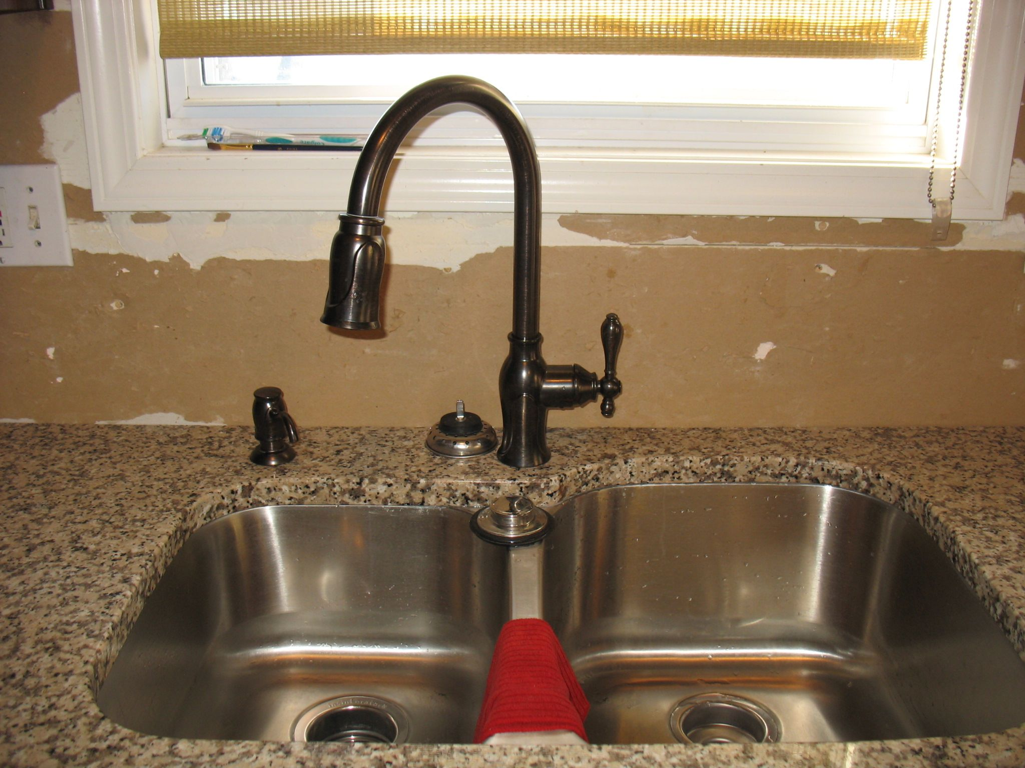 Bronze faucet kitchen pinterest faucet for Oiled bronze faucet with stainless steel sink