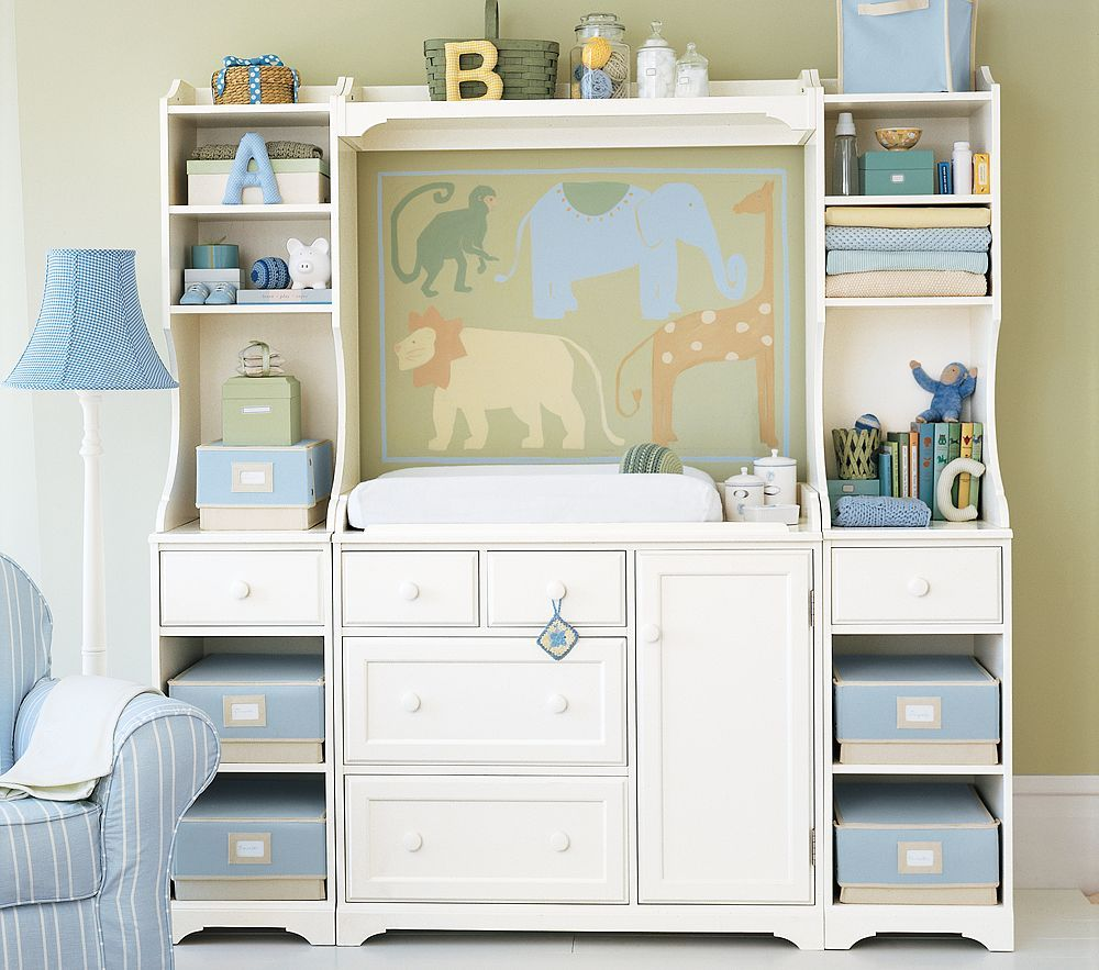 Safari wall decal over baby nursery changing table for children