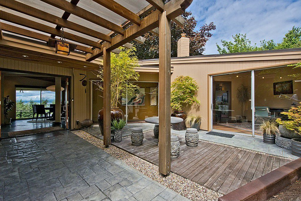 Contemporary Patio With French Doors Exterior Stone Floors Pathway