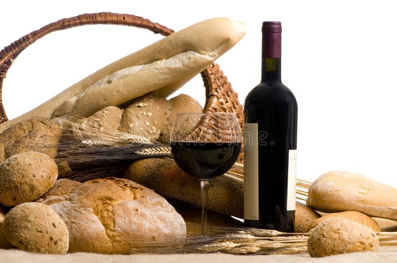 Wine with Bread Isolated on white. A glass of red wine