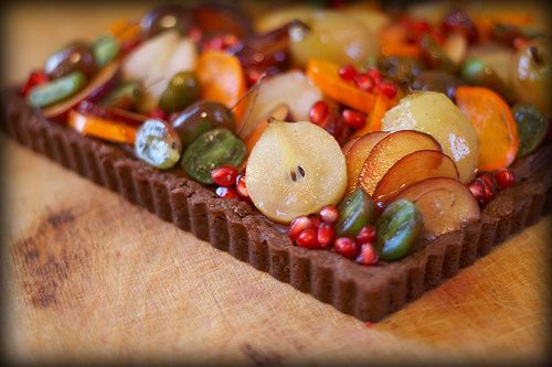 Beautiful fall fruit tart with a chocolate spiced ganache, pears, plums, and figs.