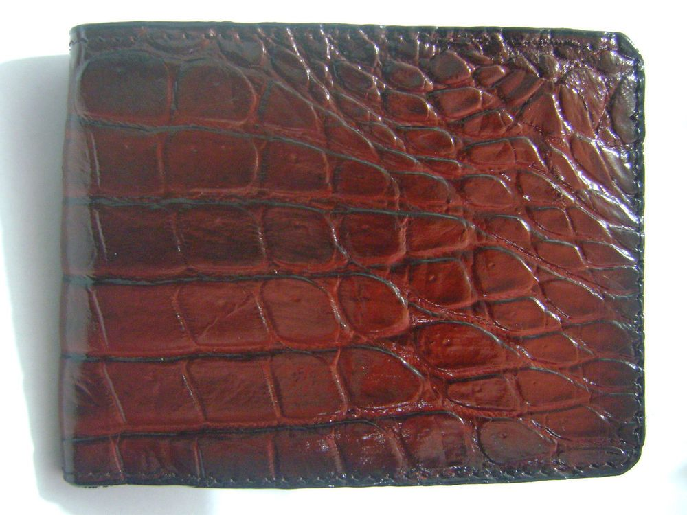 A luxury fashion men's hand wallet. Materials: Papua New Guinea Alligator Leather. Get it from manufacturer. You can bid it now on #eBay