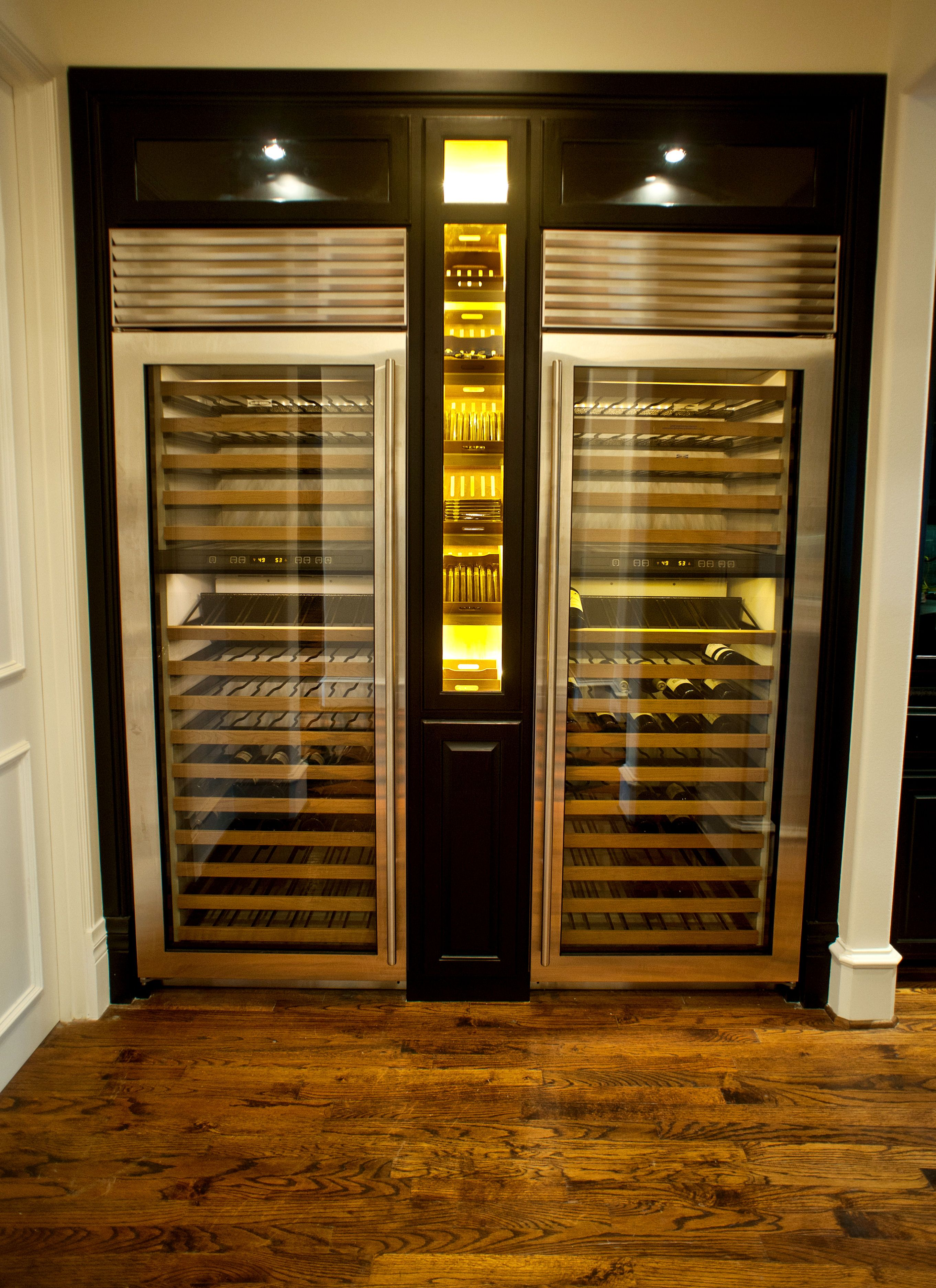 Thermador Wine Columns With Custom Cigar Humidor Adorned By LED Lighting.