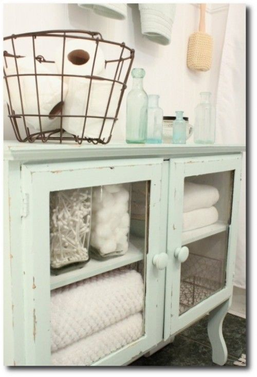 vintage dresser chest with door panels removed to show bathroom