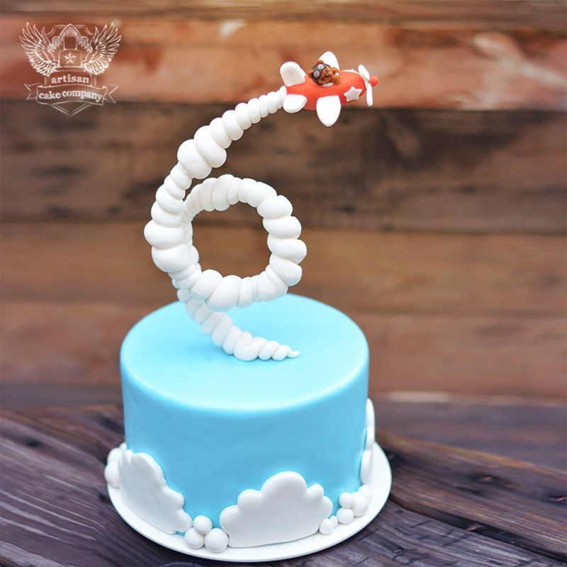 Gravity Defying Airplane Cake Tutorial (for purchase from Artisan Cake Company) - it's cool how the plane's trail looks like a 6