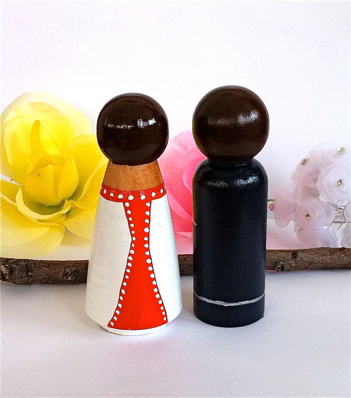 Back of peg dolls
