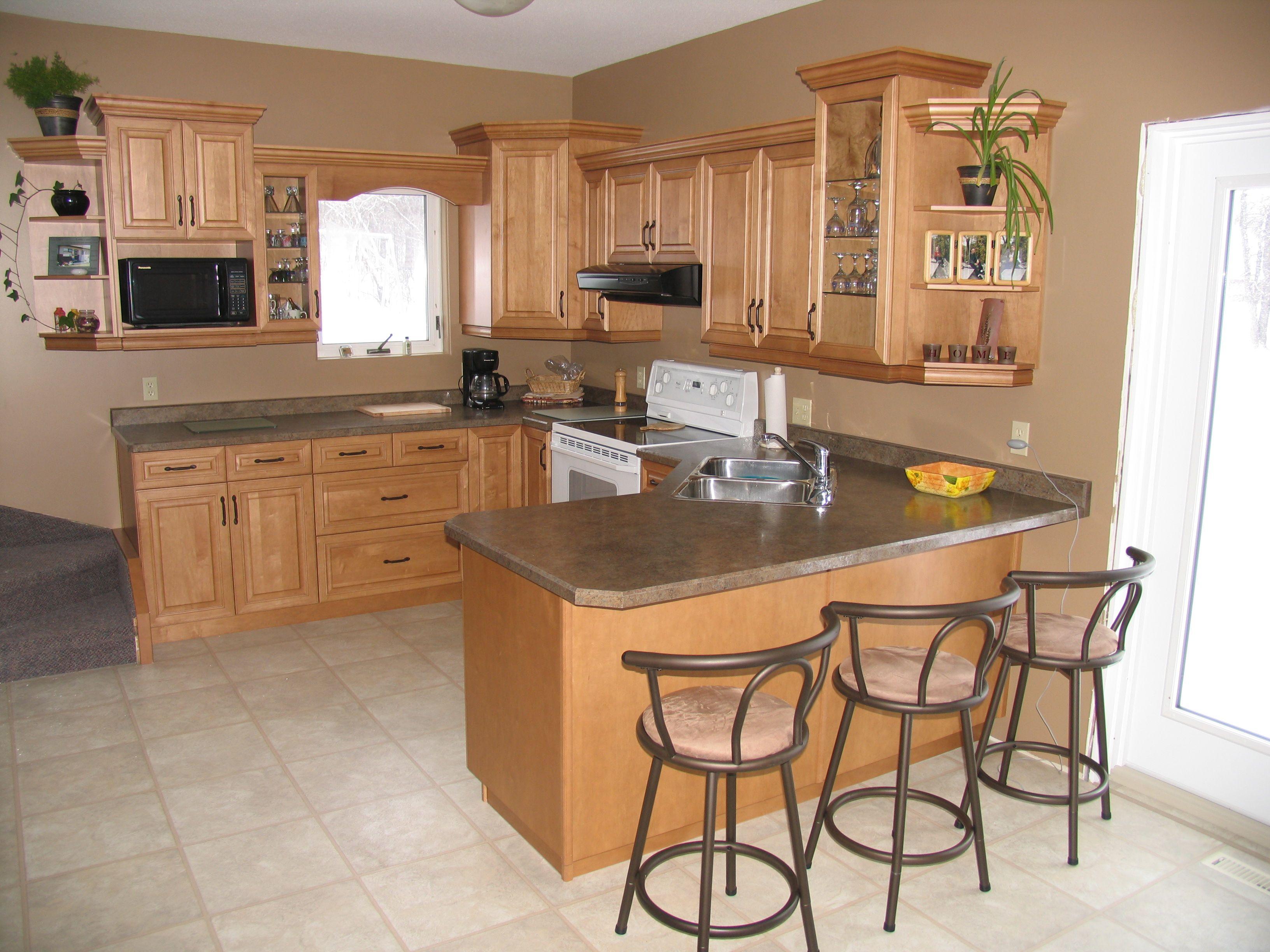 Cabinets: Maple   Wheatfield / Countertops: Wilsonart Laminate   Deepstar  Agate