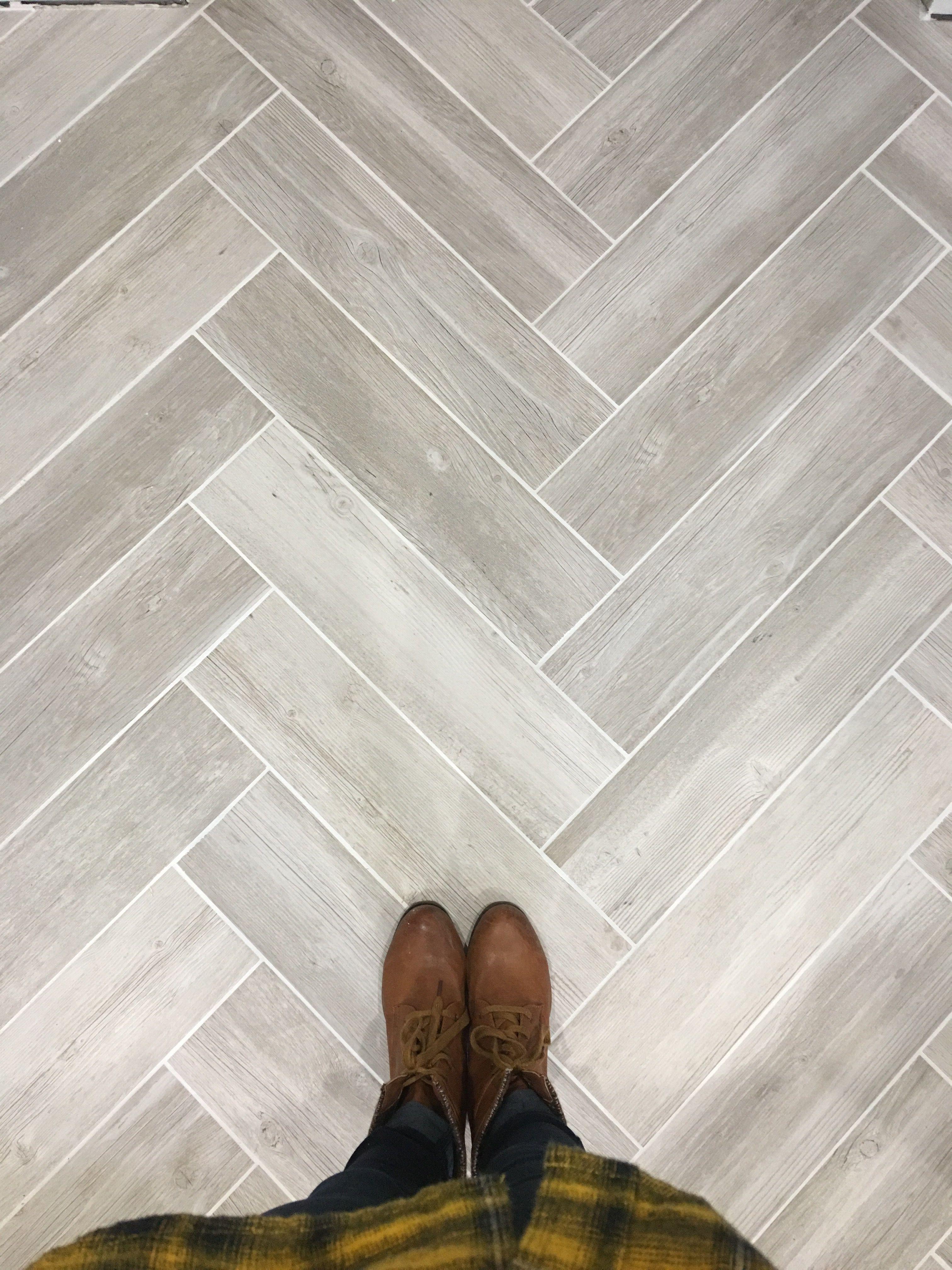 Lowe's vintage gray wood look tile in herringbone pattern