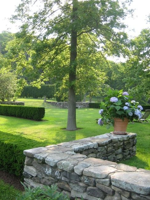 Stacked Stone, Hedges, Hydrangeas
