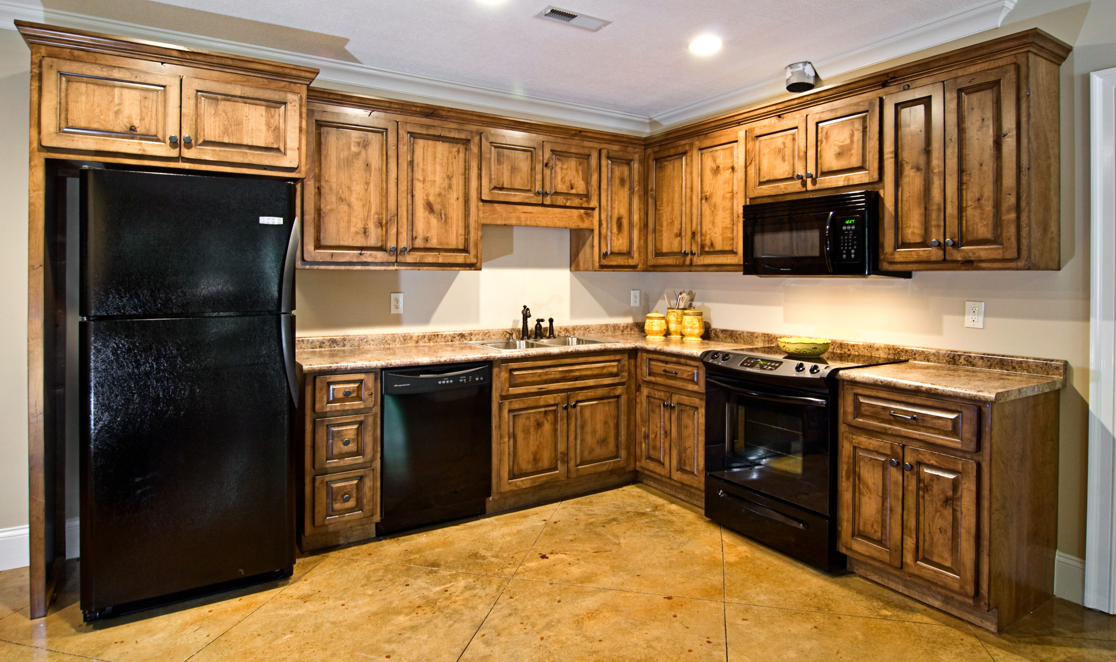 Hickory Kitchen Cabinets Pictures Knotty Alder With Coffee Stain And Black Distressing With Images Hickory Kitchen Black Appliances Kitchen Hickory Kitchen Cabinets