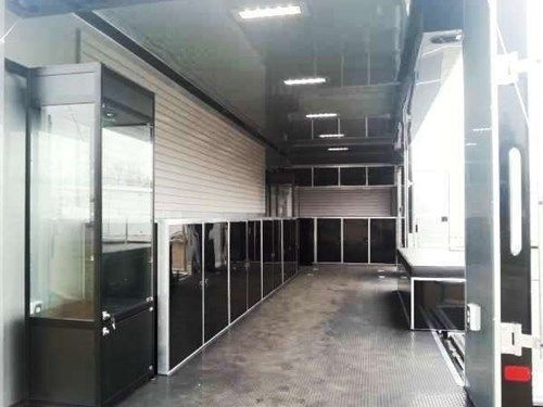 Custom Mobile 28' Storefront. This Mobile Storefront Features Plenty Of Storage, 16' Stage Door, a Custom Padded Bench, and Plenty Of Slat Wall and 2 Custom Glass Cabinets For Product Display. Call for more information on this trailer. Ref # E198573 | Advantage Trailers and Hitches