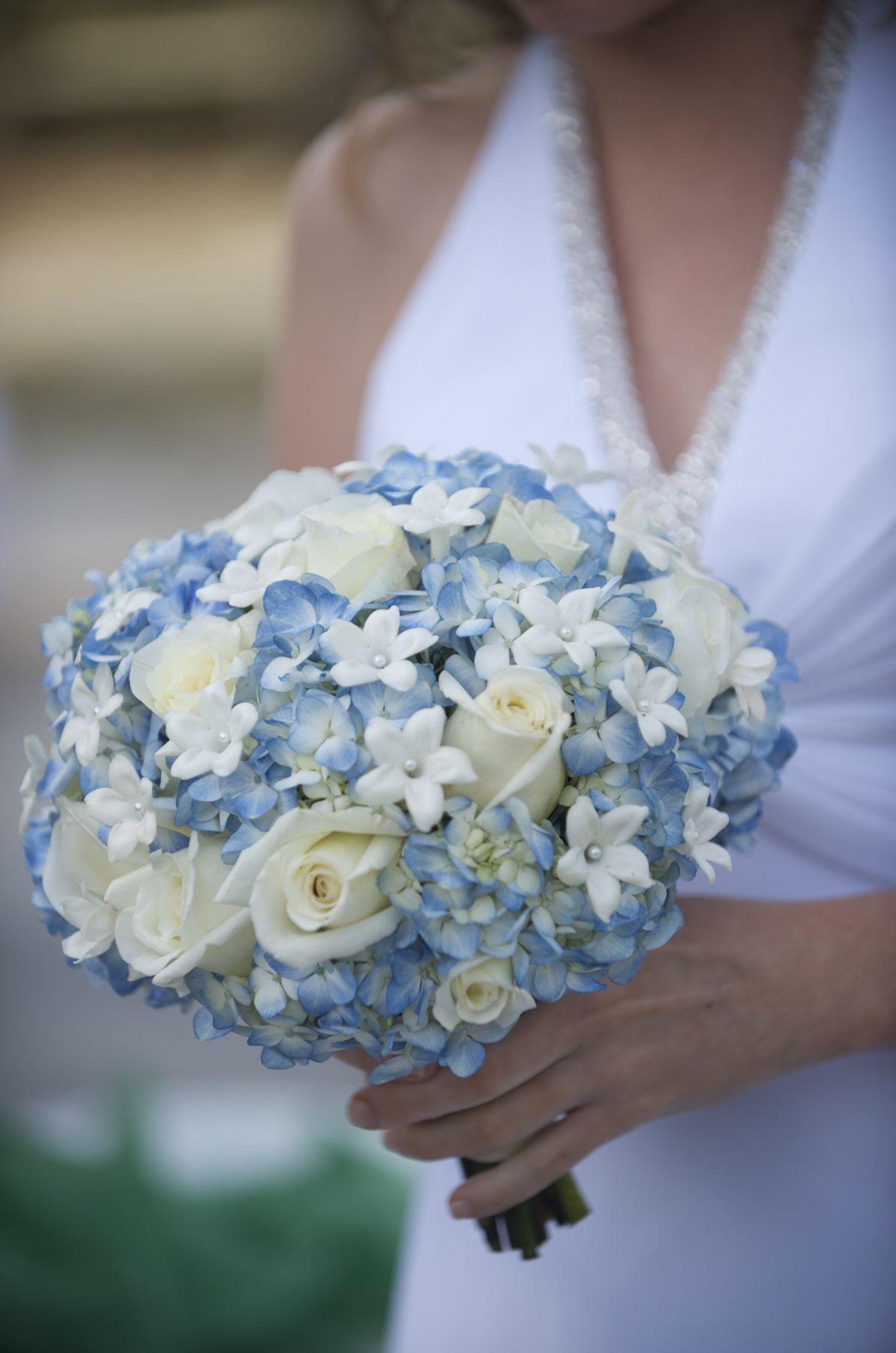 Blue hydrangeas vendelas roses ivory roses stephanotis