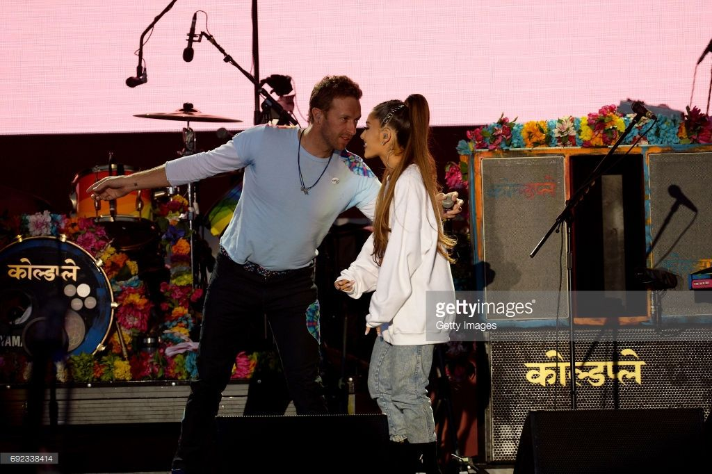 NO SALES, free for editorial use. In this handout provided by 'One Love Manchester' benefit concert (L) Chris Martin and Ariana Grande perform on stage on June 4, 2017 in Manchester, England. Donate at www.redcross.org.uk/love