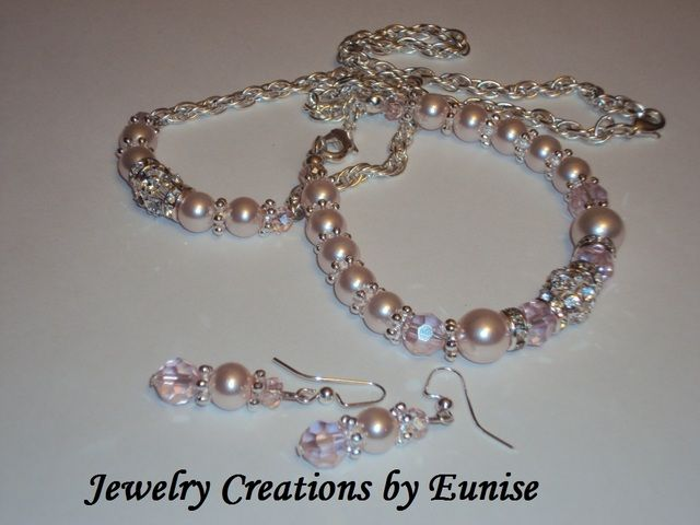 'Stunning Swarovski Crystal and Soft Pearl Set' is going up for auction at  6pm Mon, Aug 20 with a starting bid of $6.