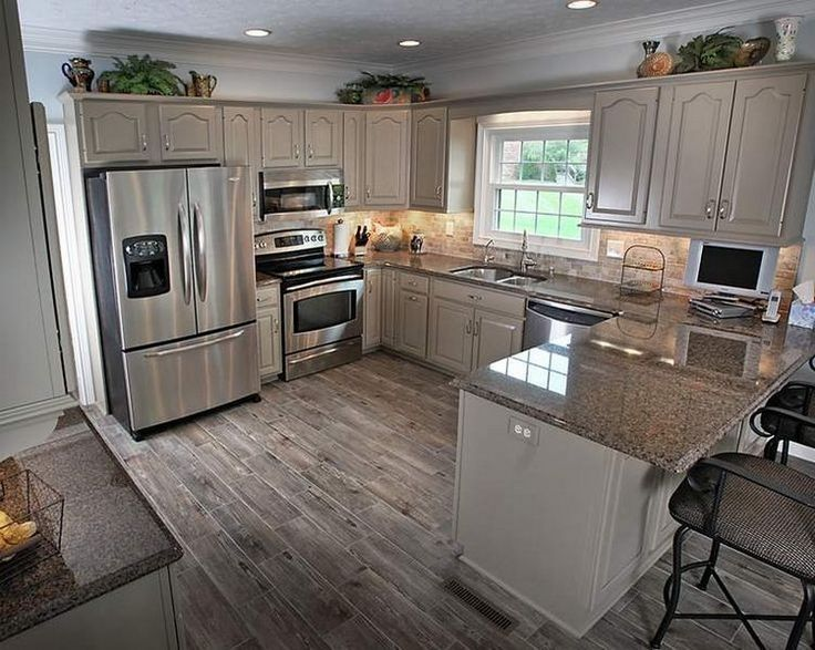 Small Kitchen With Peninsula And Recessed Lighting Over Kitchen