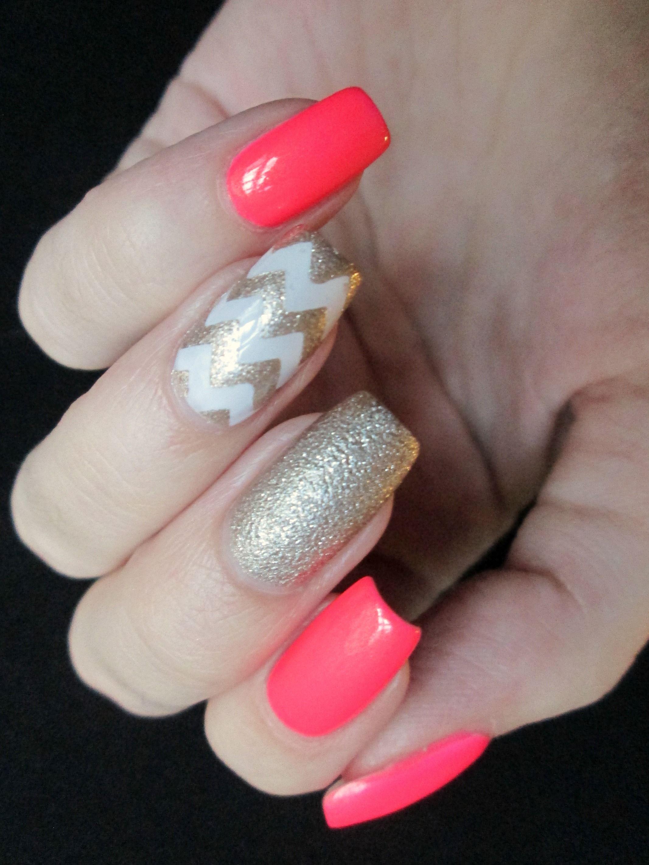 neon coral and champagne chevron nails