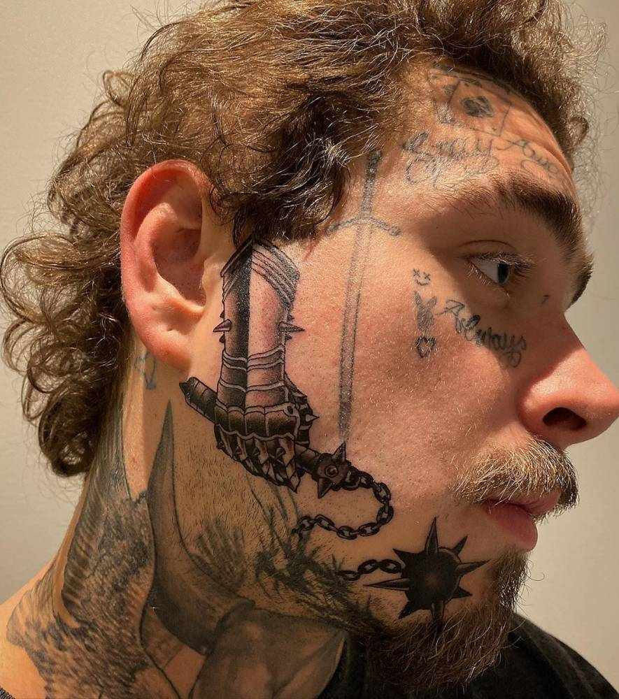 Gauntlet and flail tattoo on Post Malone's face. in 2020