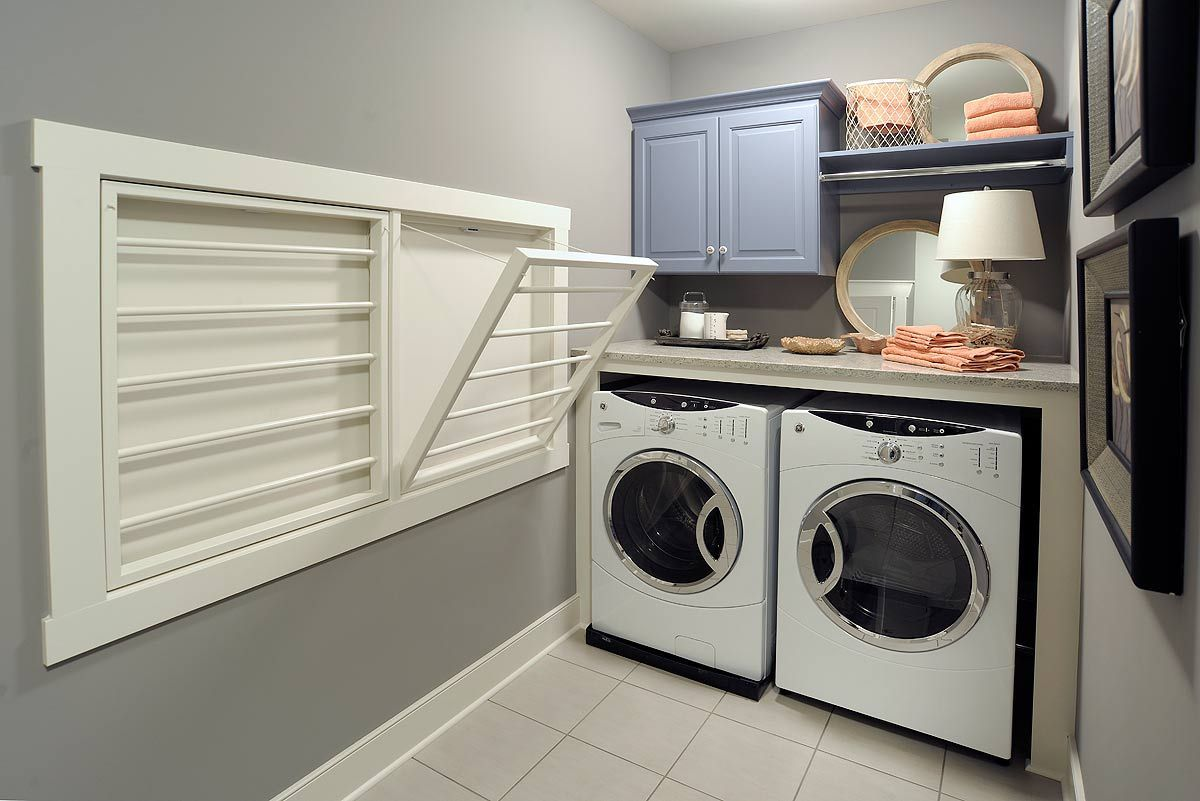 Mullet Cabinet Laundry Room Featuring Built In Drying Racks Laundry Room Design Laundry Room Renovation Elegant Laundry Room