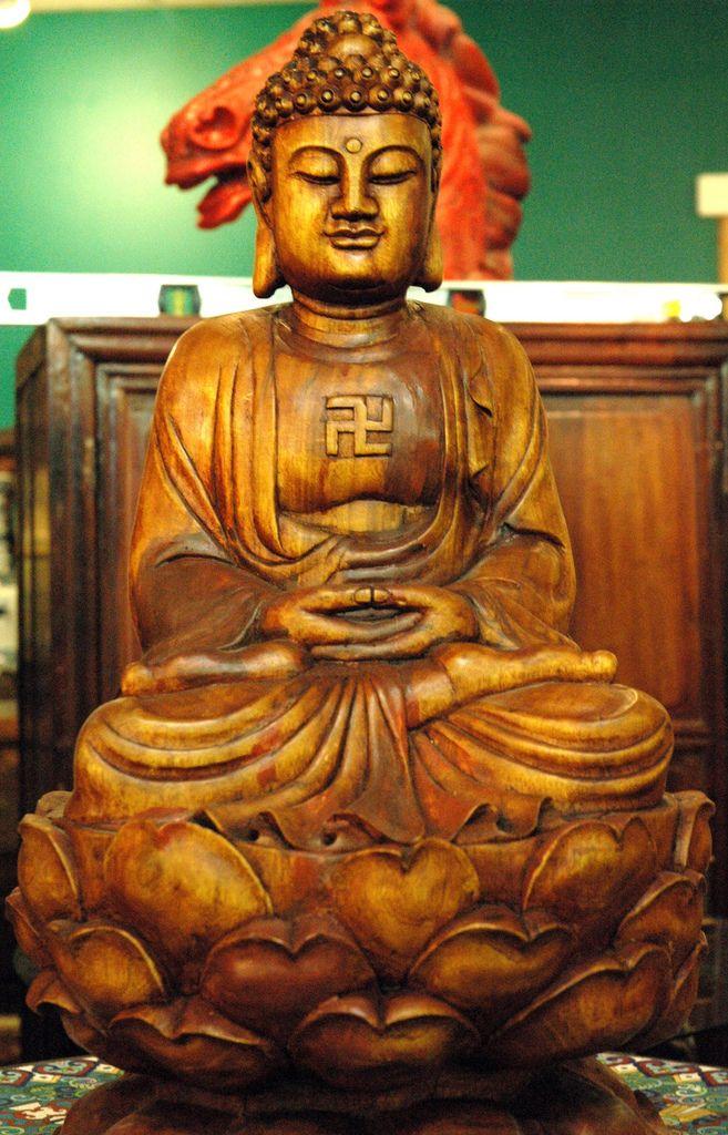 Wood Buddha In Meditation Position With Gamadian Reverse Swastika