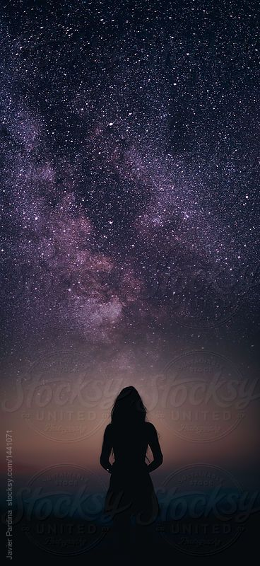 Girl looking up at the night sky