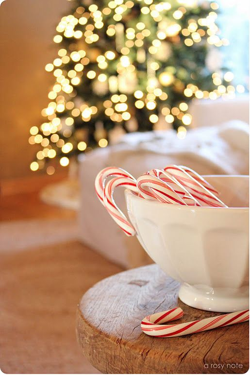 love the idea of candy canes in a white bowl