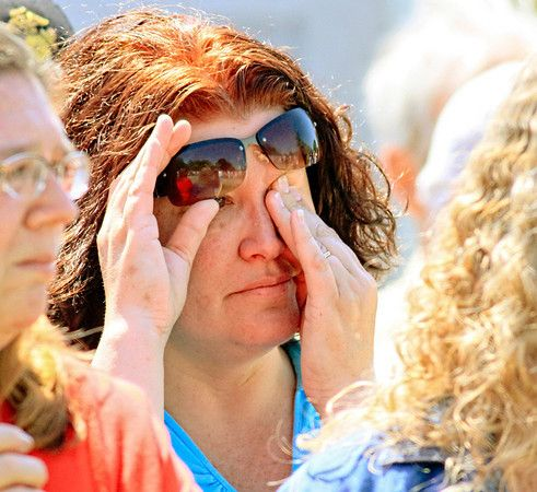 Morning Journal/Wayne Maris. Arleen DeVivo of Columbiana wipes her eyes as she thinks of her son Zachary, who is serving in the U.S. Army and stationed in Fort Lewis in Washington State. DeVivo was attending Monday's Memorial Day  services in Columbiana.