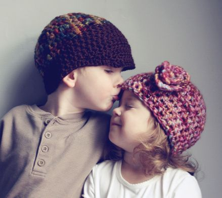 Cute Little Boy Kissing Little Girl On The Forehead They Are Both