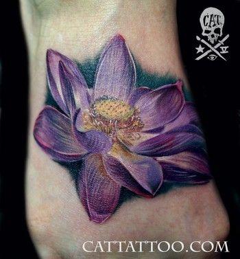 Purple Ink Lotus Flower Tattoo On Foot Ideas And Designs With Images Purple Lotus Tattoo Flower Tattoo Foot Realistic Lotus Tattoo