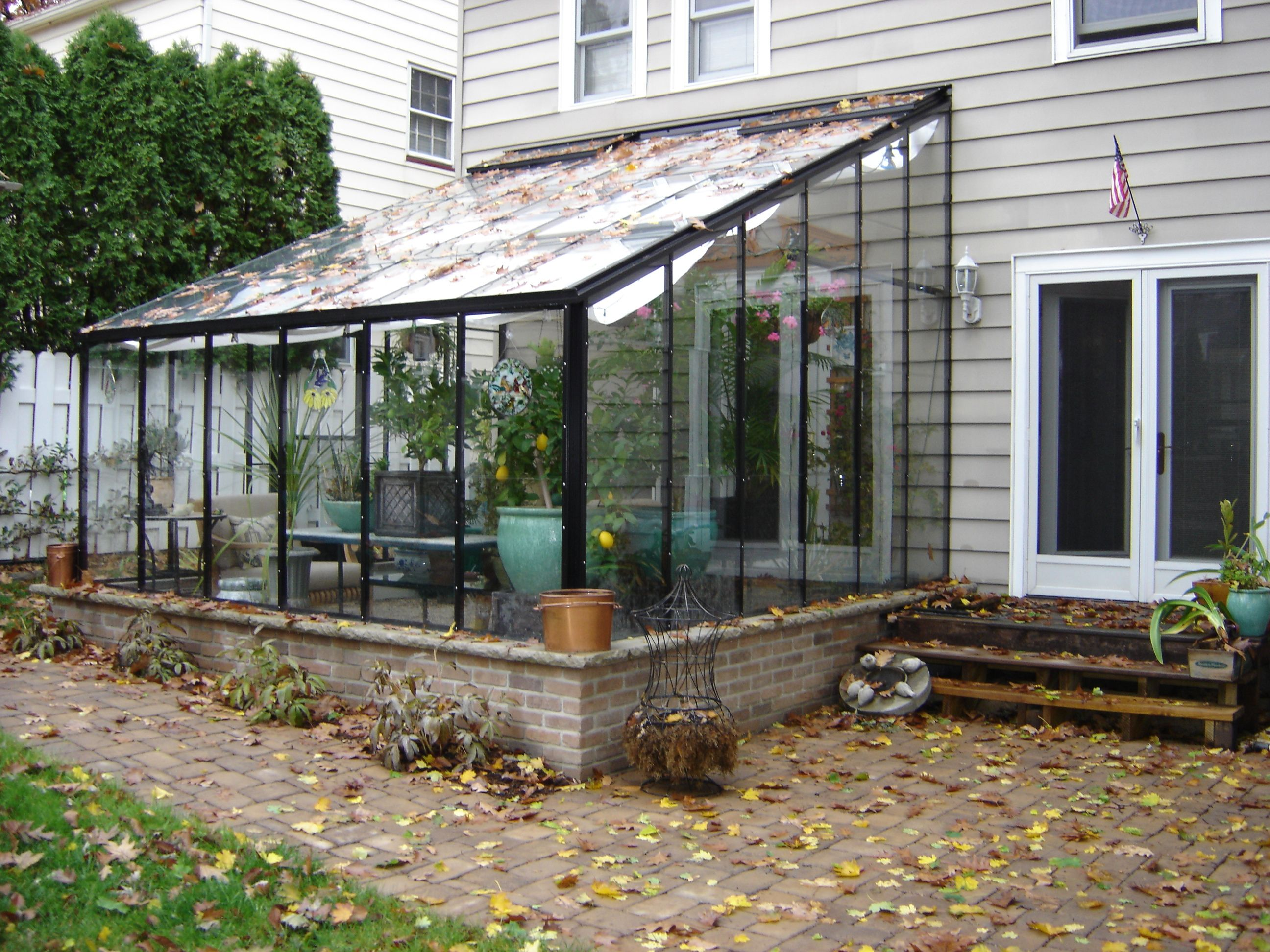 This Acadian Lean To Greenhouse Has An Optional Black Frame The Customers Use This As Double Duty Of A Greenhouse And A Lean To Greenhouse Greenhouse Lean To