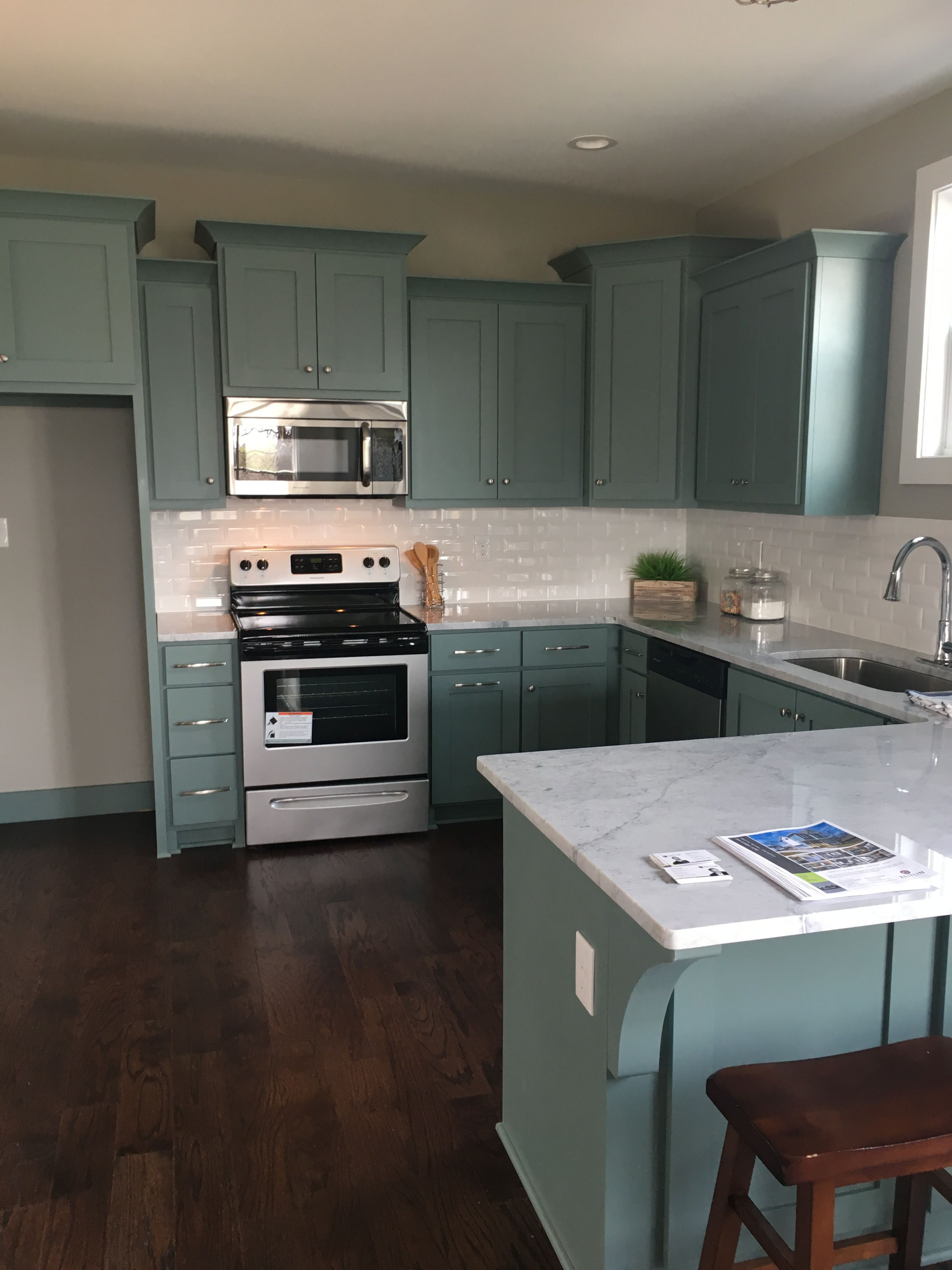 Blue kitchen cabinets, super white granite, nickel fixtures. Sherwin ...