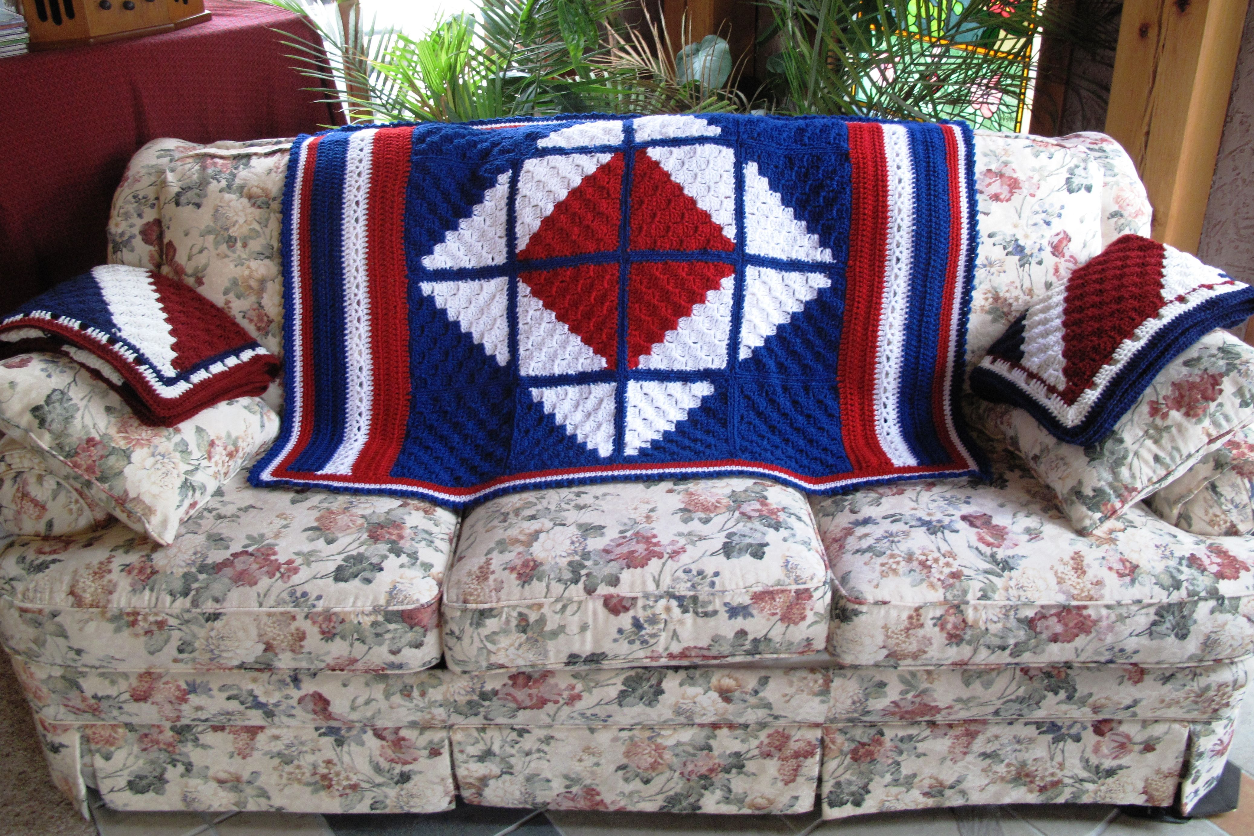 """Using a corner-stitch pattern, I made 10"""" squares to create this lap afghan for a Vet on Veteran's Day."""