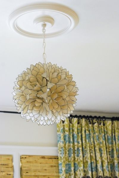 Love this chandelier made of translucent capiz shells edged in love this chandelier made of translucent capiz shells edged in metal aloadofball Images