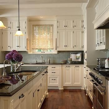 Ivory Kitchen Cabinets With Black Countertops Transitional