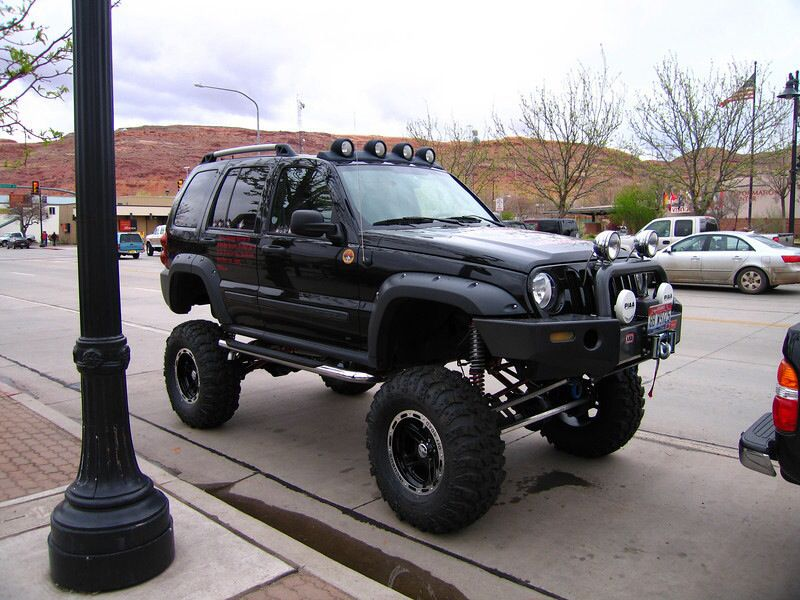 A lifted 2002 Jeep Liberty Sport with fog lights. I don't
