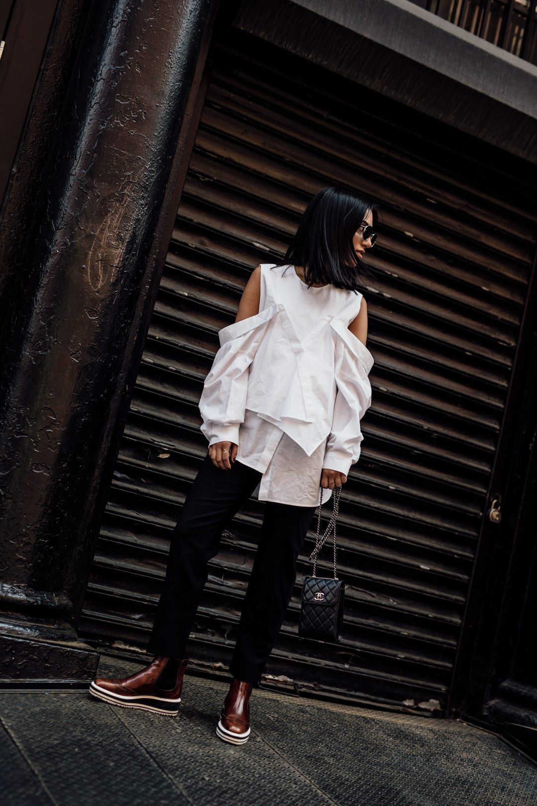 e3c8eb986330 LA Blogger Tania Sarin in NYC wearing enfold cold shoulder top and prada  booties