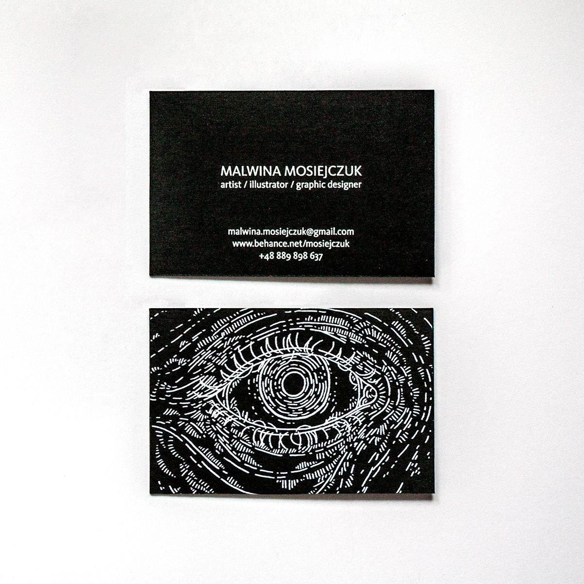 My current business card. I like the symbol of eye and it