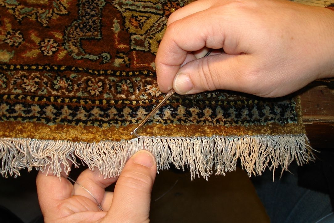 The end is secured by weaving a new chain stitch in the end.  This secures the silk and gives the rug a finished look. #rugrepair, #silkrugrepair, #orientalrugrepair #rugrestoration #persianrugrepair #rugreweaving #orientalrugrestoration