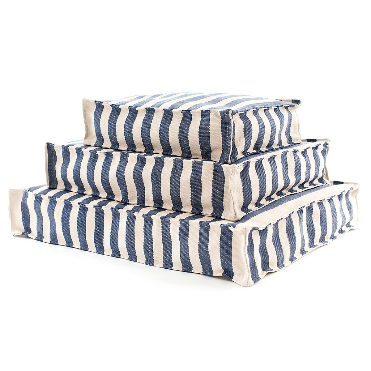 """This navy striped, nautical indoor/outdoor WOUF™ is made of durable, washable polypropylene and filled with polystyrene beads. Its the a perfect addition to the boat or deck, the kids' room, and as a dog or cat bed!   • 100% polypropylene shell; filled with polystyrene beads.  • 30""""x 40""""x 6"""", 24""""x 32""""x 6"""", and 18""""x 24""""x 6""""."""