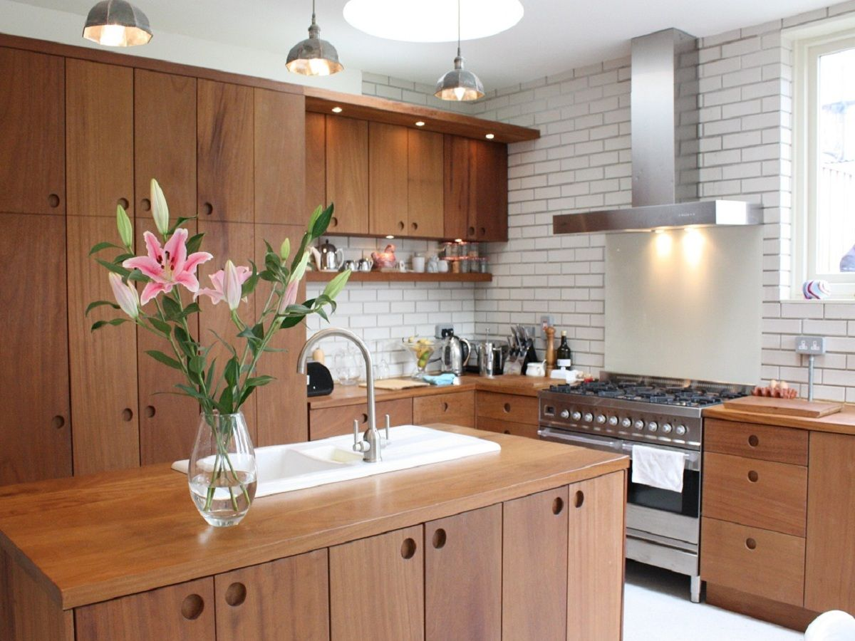 "solid iroko"" unique kitchen design, using #iroko wood cabinetry"