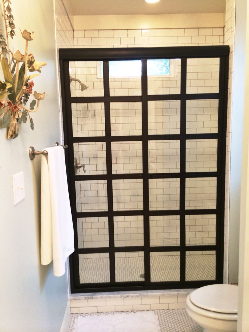 steel framed shower doors with black bronze anodized finish and clear glass