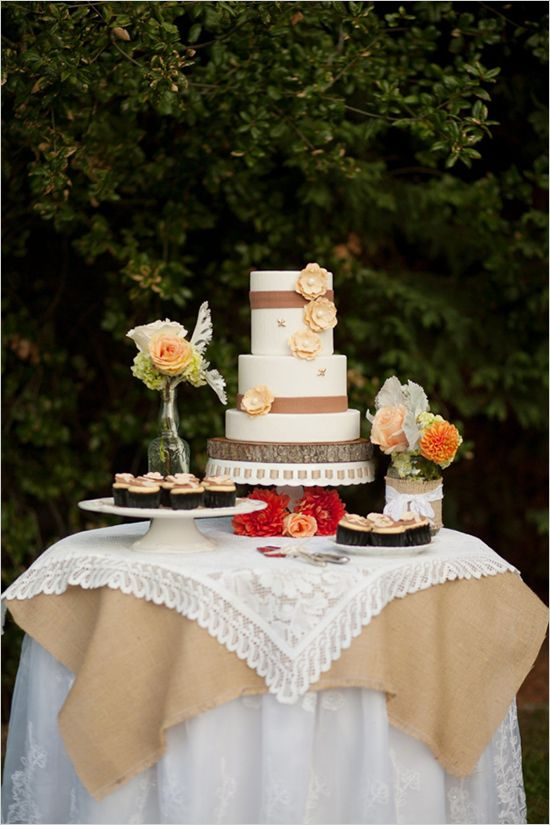 how to decorate a wedding cake table burlap linens and flowers nicely displayed cake by 15660