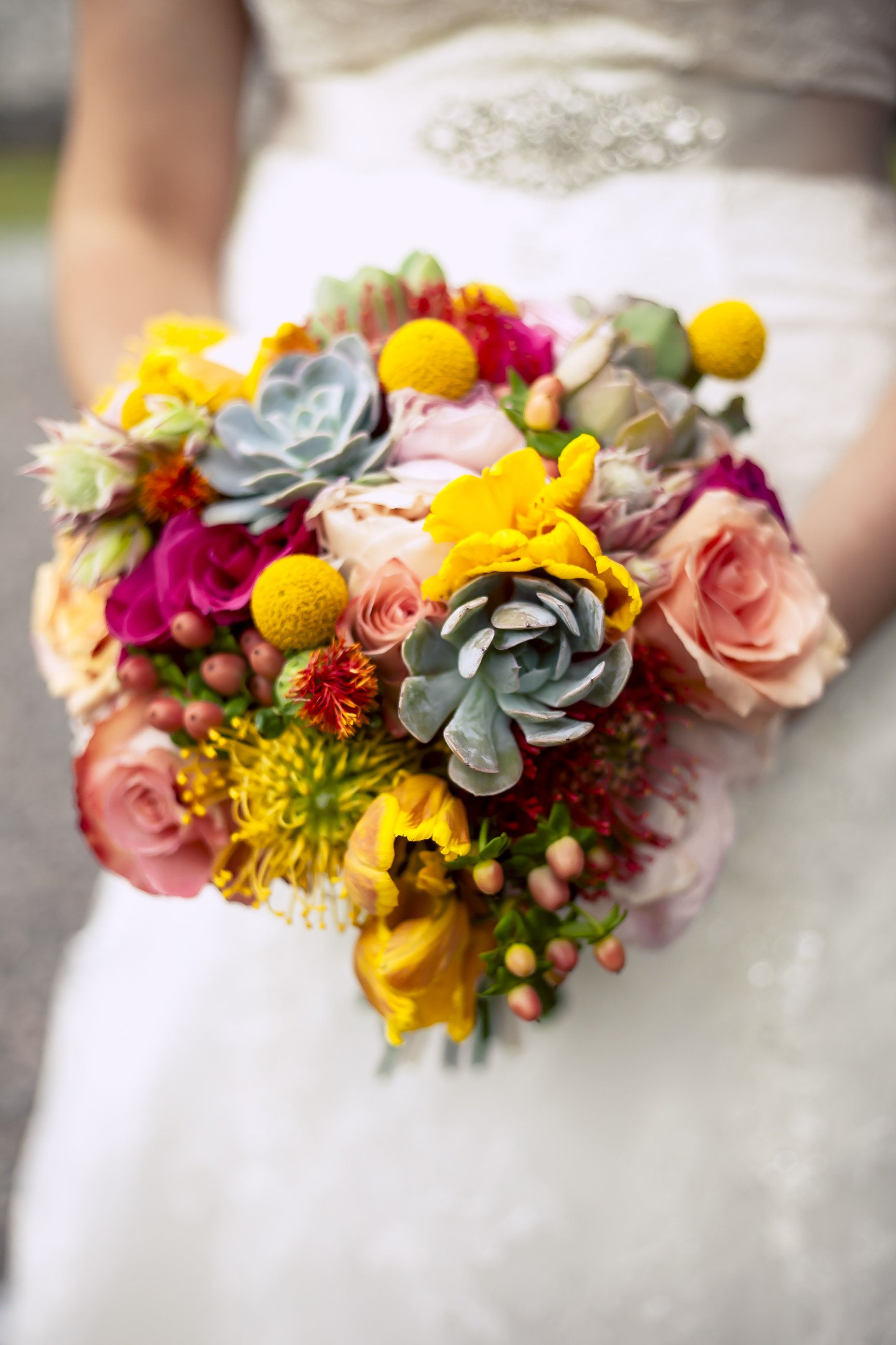 Absolutely #stunning #flowers for the #bride by @Ashley Urban Poppy! We love this #bright, #bold + #beautiful #blend of #florals. From #succulents to #roses to #waxberry + #more! ::Sarah + Zach's bright + cheery wedding at the Savannah Railroad Roundhouse and Museum in Georgia:: #floraldesign #floralarrangement #bridalbouquet #gorgeous #weddingflowers #savannahwedding #weddingphotography #pink #yellow #blue #bright #colorful
