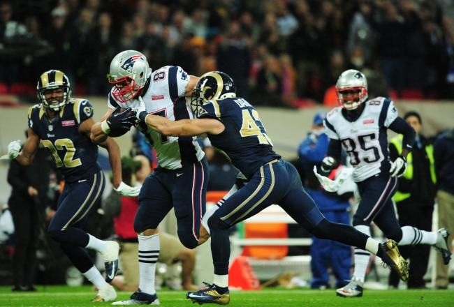 The pass-run combination of Tom Brady and Stevan Ridley proved to be too overpowering for the St. Louis Rams' defense.    Brady threw four touchdown passes, Ridley totaled 127 yards and a score on the ground and the New England Patriots engineered a tremendous all-around effort in a 45-7 rout at Wembley Stadium.