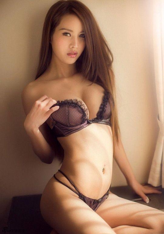 Woman masterbates on bed