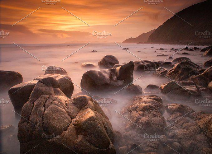 Beach with rocks at sunset Photos Beach with rocks at sunset . This beach is called Campelo and is located in Valdovi?o, Galicia, Spai by Photoweb00